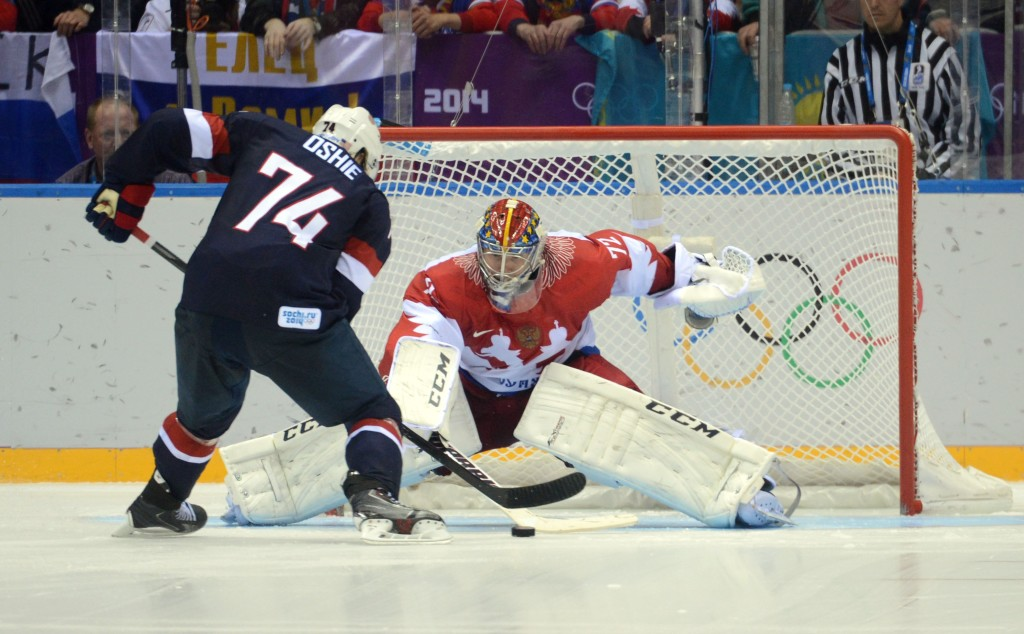 Feb 15, 2014; Sochi, RUSSIA; USA forward T.J. Oshie (74) scores a goal past Russia goalkeeper Sergei Bobrovski (72) in an overtime shootout in a men's preliminary round ice hockey game during the Sochi 2014 Olympic Winter Games at Bolshoy Ice Dome. Mandatory Credit: Jayne Kamin-Oncea-USA TODAY Sports