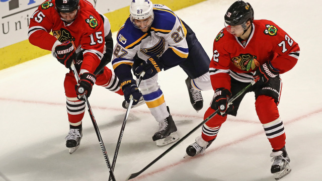CHICAGO, IL - OCTOBER 12: Alex Pietrangelo #27 of the St. Louis Blues gets between Artem Anisimov #15 and Artemi Panarin #72 of the Chicago Blackhawks during the season opening game at the United Center on October 12, 2016 in Chicago, Illinois. (Photo by Jonathan Daniel/Getty Images)